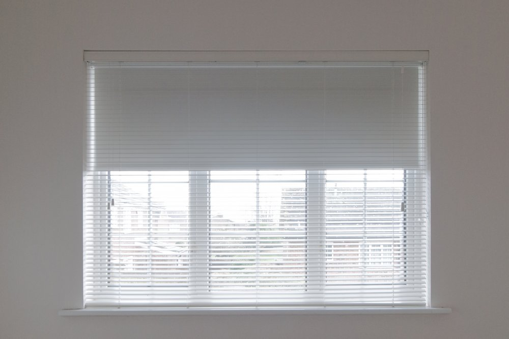 Pure White with strings with blackout roller blind