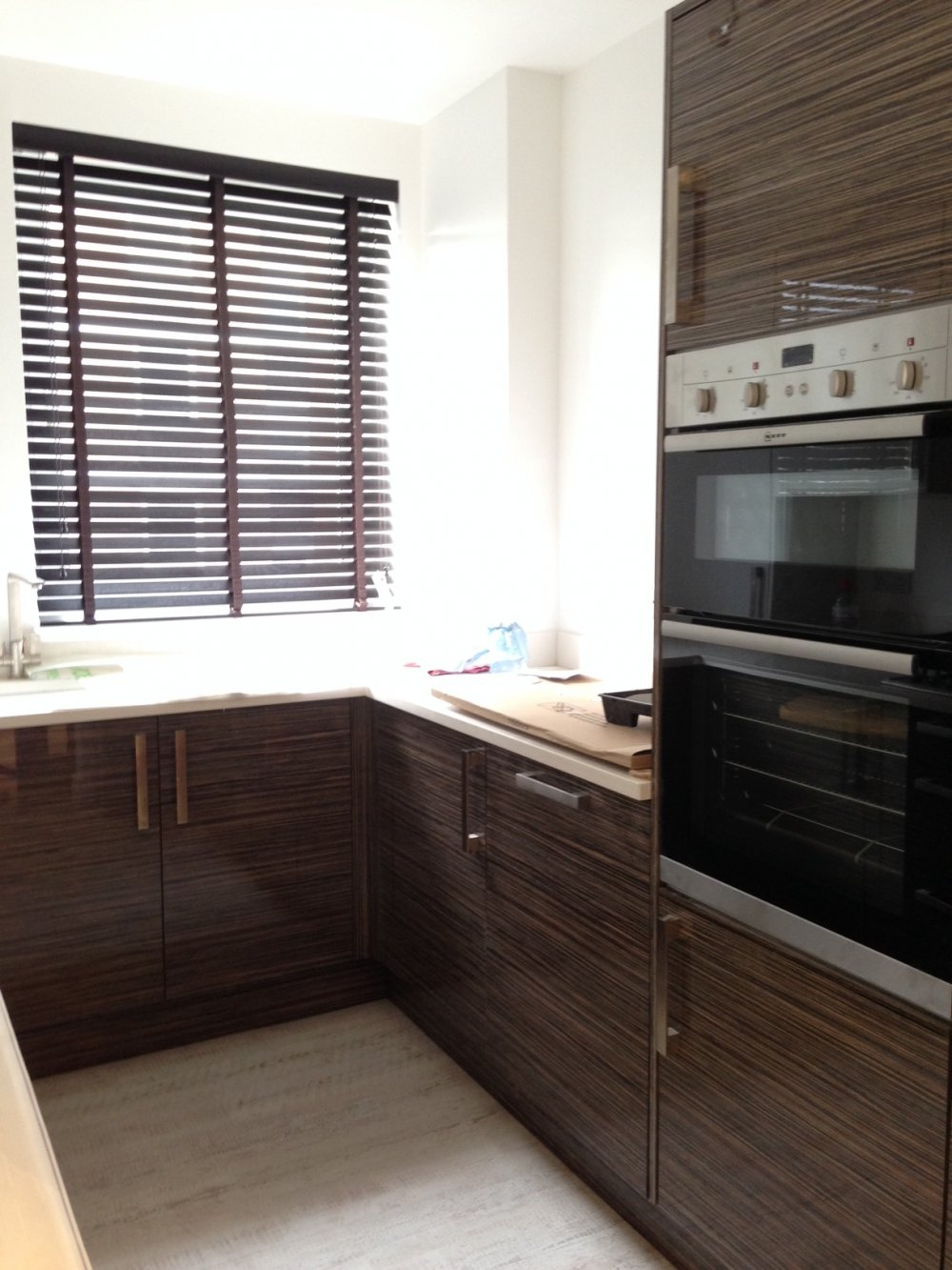 Wood venetian blind with matching tape for kitchen window
