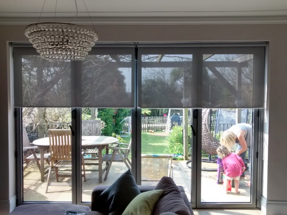 Sunscreen roller blinds for bifold doors